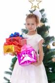 The girl at the Christmas tree — Stock Photo