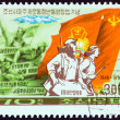 "NORTH KOREA - CIRCA 1976: A stamp printed in North Korea from the ""30th anniversary of Korean League of Socialist Working Youth "" issue shows Marchers with Flags, circa 1976. — Stock Photo #52576249"