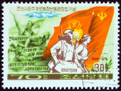 "NORTH KOREA - CIRCA 1976: A stamp printed in North Korea from the ""30th anniversary of Korean League of Socialist Working Youth "" issue shows Marchers with Flags, circa 1976. — Stock Photo"