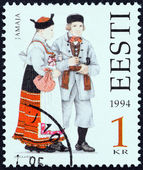 "ESTONIA - CIRCA 1994: A stamp printed in Estonia from the "" Folk Costumes "" issue shows traditional clothing from Jamaja, circa 1994. — Stock Photo"