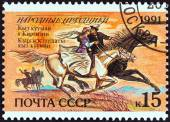 "USSR - CIRCA 1991: A stamp printed in USSR from the ""Folk Festivals "" issue shows Couple on horses (Kirghizia), circa 1991. — Stock Photo"