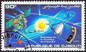 "DJIBOUTI - CIRCA 1986: A stamp printed in Djibouti from the ""Appearance of Halley's Comet "" issue shows Solar system, comet trajectory and space probes Giotto and Vega 1, circa 1986. — Stock Photo"
