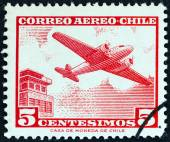 CHILE - CIRCA 1964: A stamp printed in Chile shows Douglas DC-2 and control tower, circa 1964. — Stock Photo
