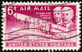 USA - CIRCA 1949: A stamp printed in USA issued for the 46th anniversary of Wright Brothers' First Flight shows Wright brothers and Wright Flyer I plane, circa 1949. — Stock Photo