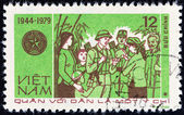 """VIETNAM - CIRCA 1979: A stamp printed in Vietnam from the """"35th anniversary of Vietnam People's Army """" issue shows people greeting soldiers, circa 1979. — Stock Photo"""