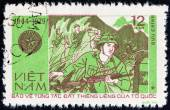 """VIETNAM - CIRCA 1979: A stamp printed in Vietnam from the """"35th anniversary of Vietnam People's Army """" issue shows battle scene, circa 1979. — Stock Photo"""