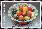 """THAILAND - CIRCA 1990: A stamp printed in Thailand from the """"International letter writing week """" issue shows fruits in bowl (Luk Chup) , circa 1990. — Stock Photo"""