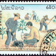 "LAOS - CIRCA 1991: A stamp printed in Laos from the ""National Tree Planting Day "" issue shows planting Saplings , circa 1991. — Stock Photo #56688229"