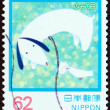 "JAPAN - CIRCA 1992: A stamp printed in Japan from the ""Letter Writing Day "" issue shows Bird Delivering Letter to Dog, circa 1992. — Stock Photo #56851071"
