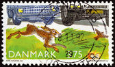 "DENMARK - CIRCA 1992: A stamp printed in Denmark from the ""Environmental Protection "" issue shows Hare, Eurasian Sky Lark and cars, circa 1992. — Zdjęcie stockowe"