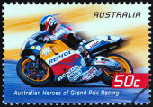 "AUSTRALIA - CIRCA 2004: A stamp printed in Australia from the ""Australian Heroes of Grand Prix Racing "" issue shows Mick Doohan (Repsol Honda), circa 2004. — Foto Stock"