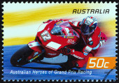 "AUSTRALIA - CIRCA 2004: A stamp printed in Australia from the ""Australian Heroes of Grand Prix Racing "" issue shows Troy Bayliss (Ducati), circa 2004. — Стоковое фото"