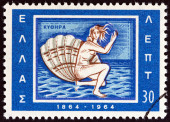 """GREECE - CIRCA 1964: A stamp printed in Greece from the """"Centenary of Union of Ionian Islands with Greece"""" issue shows birth of Aphrodite emblem of Kythera, circa 1964. — Stock Photo"""