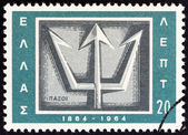 """GREECE - CIRCA 1964: A stamp printed in Greece from the """"Centenary of Union of Ionian Islands with Greece"""" issue shows Trident emblem of Paxoi, circa 1964. — Stockfoto"""