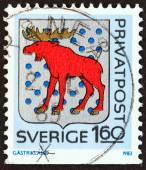 "SWEDEN - CIRCA 1983: A stamp printed in Sweden from the ""Rebate Stamps. Arms of Swedish Provinces (3rd series)"" issue shows Gastrikland coat of arms, circa 1983. — Stock Photo"