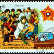 "LAOS - CIRCA 1989: A stamp printed in Laos from the ""40th anniversary of People's Army "" issue shows Army medics vaccinating civilians, circa 1989. — Stock Photo #59412029"