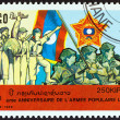 "LAOS - CIRCA 1989: A stamp printed in Laos from the ""40th anniversary of People's Army "" issue shows peasant, revolutionary, worker and soldiers, circa 1989. — Stock Photo #59412087"