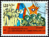 """LAOS - CIRCA 1989: A stamp printed in Laos from the """"40th anniversary of People's Army """" issue shows peasant, revolutionary, worker and soldiers, circa 1989. — Stock Photo"""