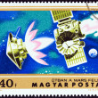 "HUNGARY - CIRCA 1974: A stamp printed in Hungary from the ""Mars Exploration "" issue shows Mariner 4 on course for Mars, circa 1974. — Stock Photo #59627369"
