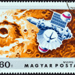 "HUNGARY - CIRCA 1974: A stamp printed in Hungary from the ""Mars Exploration "" issue shows Mars 2 approaching Mars, circa 1974. — Stock Photo #59627385"