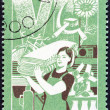 "VIETNAM - CIRCA 1987: A stamp printed in Vietnam from the ""6th Party Congress Decisions "" issue shows Increase in Industrial Production (woman carrying bales of cloth), circa 1987. — Stock Photo #59627589"