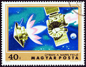 """HUNGARY - CIRCA 1974: A stamp printed in Hungary from the """"Mars Exploration """" issue shows Mariner 4 on course for Mars, circa 1974. — Stock Photo"""