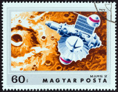 """HUNGARY - CIRCA 1974: A stamp printed in Hungary from the """"Mars Exploration """" issue shows Mars 2 approaching Mars, circa 1974. — Stock Photo"""