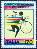 ITALY - CIRCA 1979: A stamp printed in Italy issued for the World Cyclo-cross Championships shows cyclist carrying bicycle , circa 1979. — Stok fotoğraf