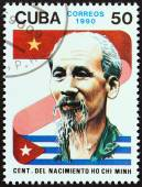 CUBA - CIRCA 1990: A stamp printed in Cuba issued for the birth centenary of Vietnamese leader Ho Chi Minh shows flags and Ho Chi Minh, circa 1990. — ストック写真