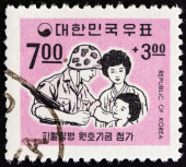 SOUTH KOREA - CIRCA 1967: A stamp printed in South Korea issued for the Fund for Korean Troops Serving in Vietnam shows Soldier and Family, circa 1967. — Stok fotoğraf