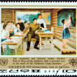 "NORTH KOREA - CIRCA 1979: A stamp printed in North Korea from the ""International Year of the Child "" issue shows Kim Il Sung and childrens corps members in classroom, circa 1979. — Stock Photo #64564383"