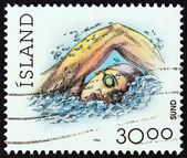 "ICELAND - CIRCA 1994: A stamp printed in Iceland from the ""Sports "" issue shows swimming, circa 1994. — Stock Photo"