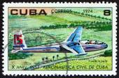 "CUBA - CIRCA 1974: A stamp printed in Cuba from the ""The 10th Anniversary of The Civil Aeronautical Institute "" issue shows Glider in flight, circa 1974. — Stock Photo"