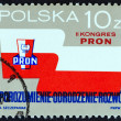 POLAND - CIRCA 1987: A stamp printed in Poland issued for the 2nd Patriotic Movement for National Revival Congress shows emblem and banner, circa 1987. — Stock Photo #65225313