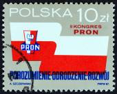 POLAND - CIRCA 1987: A stamp printed in Poland issued for the 2nd Patriotic Movement for National Revival Congress shows emblem and banner, circa 1987. — Stock Photo