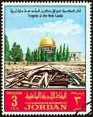 """JORDAN - CIRCA 1969: A stamp printed in Jordan from the """"Tragedy in the Holy Lands """" issue shows wrecked house, with Dome of the Rock in background, circa 1969. — Stock Photo"""