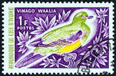 "IVORY COAST - CIRCA 1966: A stamp printed in Ivory Coast from the ""Birds "" issue shows Bruce's Green-pigeon (Treron waalia), circa 1966. — Stock Photo"