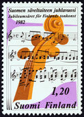 "FINLAND - CIRCA 1982: A stamp printed in Finland from the ""Music Jubilee "" issue shows Neck of Stringed Instrument and Staves of Music, circa 1982. — Stock Photo"