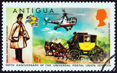 ANTIGUA - CIRCA 1974: A stamp printed in Antigua issued for the Centenary of U.P.U. shows English Postman, Mailcoach and Westland Dragonfly Helicopter, circa 1974. — Stock Photo