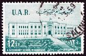 UNITED ARAB REPUBLIC SYRIA - CIRCA 1959: A stamp printed in Syria shows Al-Haschimi Secondary School, Damascus, circa 1959. — Stock Photo
