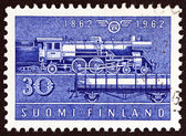 FINLAND - CIRCA 1962: A stamp printed in Finland issued for the 100th anniversary of the railway shows Class Hr-1 steam locomotive and Type Hk wagon, circa 1962. — Stock Photo