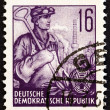 "GERMAN DEMOCRATIC REPUBLIC - CIRCA 1953: A stamp printed in Germany from the ""Five Year Plan"" issue shows Foundry worker, circa 1953. — Stock Photo #72106229"