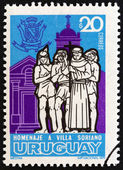 URUGUAY - CIRCA 1973: A stamp printed in Uruguay issued for the commemoration of Villa Soriano, the first Spanish settlement in Uruguay shows Priest, Indians and Soriano Church, circa 1973. — Stock Photo