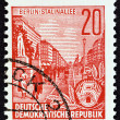 "GERMAN DEMOCRATIC REPUBLIC - CIRCA 1955: A stamp printed in Germany from the ""Five Year Plan"" issue shows Stalin Avenue, Berlin, circa 1955. — Stock Photo #72375641"