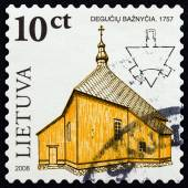 "LITHUANIA - CIRCA 2008: A stamp printed in Lithuania from the ""Wooden Sacral Architecture in Lithuania "" issue shows the church of Deguchiai, 1757, circa 2008. — Stok fotoğraf"