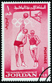 "JORDAN - CIRCA 1964: A stamp printed in Jordan from the ""Olympic Games, Tokyo "" issue shows Basketball, circa 1964. — Stock Photo"