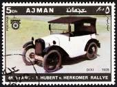 """AJMAN EMIRATE - CIRCA 1970: A stamp printed in United Arab Emirates from the """"65th Anniversary of the Hubert V. Herkomer Rallye"""" issue shows BMW Dixi of 1928, circa 1970. — Foto de Stock"""