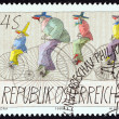"AUSTRIA - CIRCA 1985: A stamp printed in Austria from the ""Modern Art in Austria "" issue shows Clowns Riding High Bicycles (Paul Flora), circa 1985. — Stock Photo #73339419"