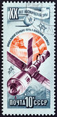 """USSR - CIRCA 1977: A stamp printed in USSR from the """"20th anniversary of Space Exploration """" issue shows Soyuz spacecraft and Salyut space station linked, circa 1977. — Stock Photo"""