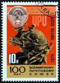 Urss - Circa 1974 : Un timbre imprimé en Urss a publié pour le centenaire de P.U. spectacles Crest soviétique et le Monument de P.U., Berne, circa 1974. — Photo